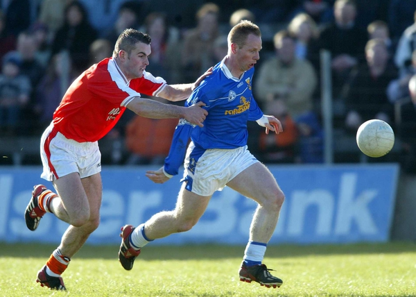 Anthony Forde of Cavan is tracked by Paul Watters of Armagh