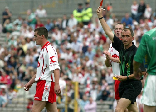 Ref Seamus McCormack shows Brian McGuigan of Tyrone the red card