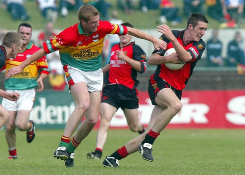 Down's Dan Gordon fends off a challenge from Carlow's Willie Power