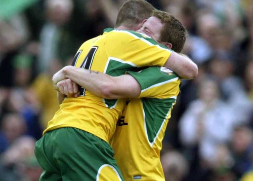 Stephen McDermott and Adrian Sweeney celebrate at the final whistle