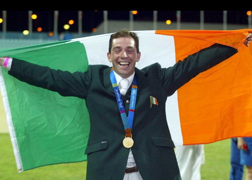 A delighted Cian O'Connor celebrates winning the gold medal