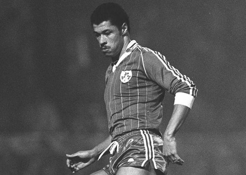 A young Paul McGrath playing for Ireland
