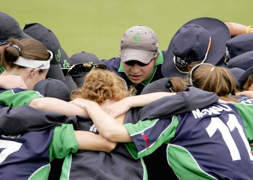 Ireland's women huddle before their abandoned match against South Africa today