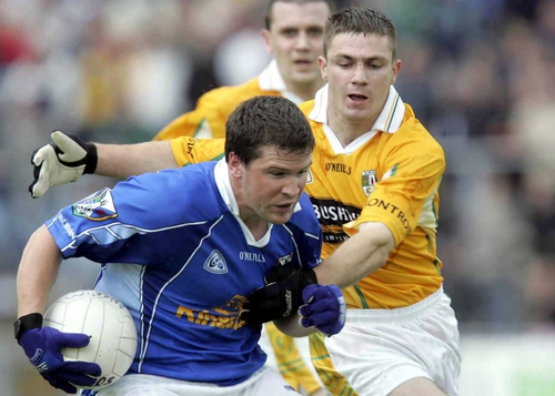 Antrim's Tony Scullion tries to tackle Larry Reilly of Cavan