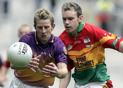 Wexford's Niall Murphy and Mark Brennan tussle for the ball