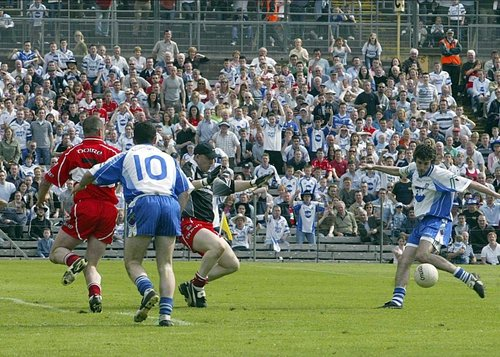 Monaghan's Hugh McElroy finished with three points as his side advanced.