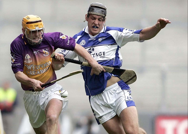 Wexford's Eoin Quigley and Darren Rooney of Laois tussle