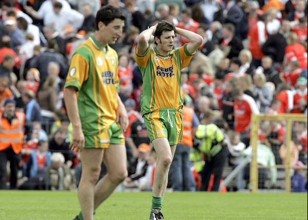 Christy Toye - far right - shows his dejection after his missed the kick that would have seen Donegal grab victory