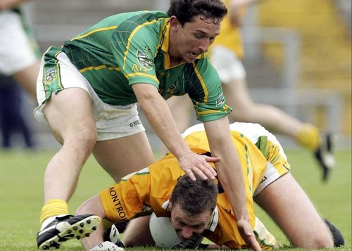 Antrim's Mark McCrory struggles to fend off Meath's David Crimmins