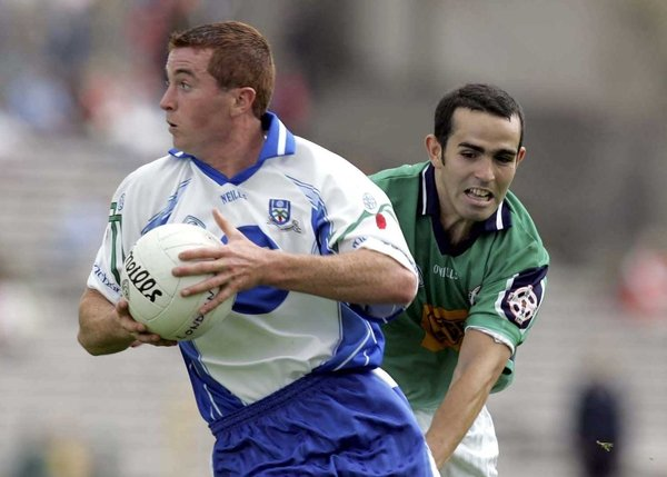 Monaghan's Thomas Freeman pulls away from James Rafter of London
