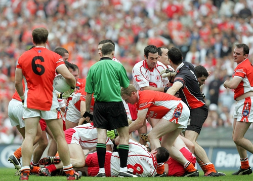 Armagh and Tyrone players tussle on the ground prior to dismissal of Tyrone's Peter Canavan and Armagh's Ciaran McKeever