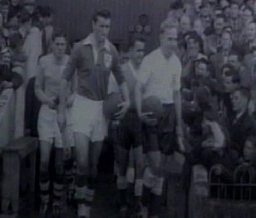 Noel Cantwell leads Ireland out against England at Dalymount Park in 1957