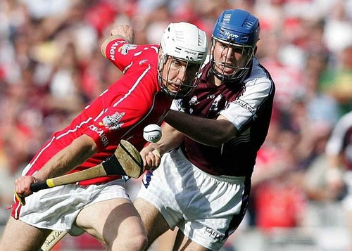 Cork's Timmy McCarthy and Galway's David Collins battle for posession