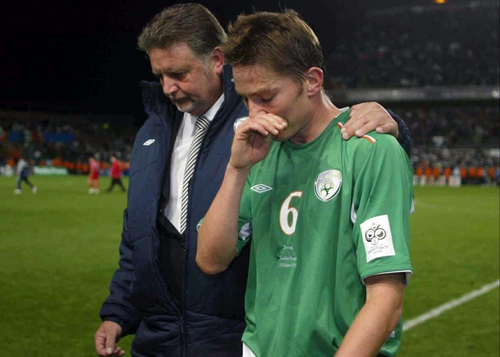 A dejected Matt Holland leaves the pitch after last night's disastrous draw with Switzerland