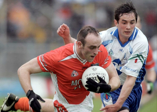 Malachy Mackin takes the ball away from Damien Freeman of Monaghan