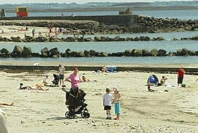 Sun bathing - Cancer society warns of under use of sun cream on hottest day