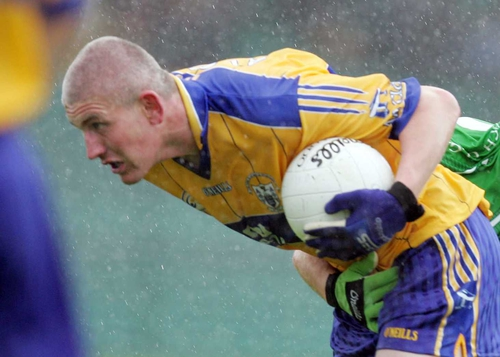 Denis Russell in action for Clare footballers