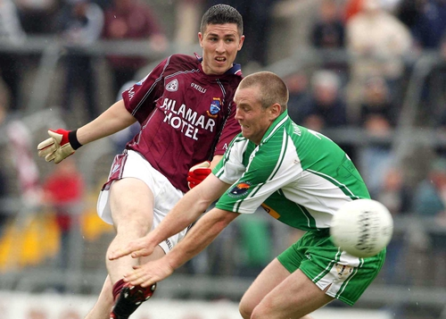 Westmeath's Gary Dolan get in his shot depsite the efforts of London's Conor Beirne