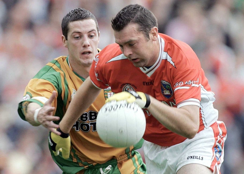 Armagh's Oisín McConville goes past Donegal's Barry Dunnion