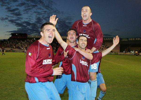 Drogheda players celebrate a famous victory