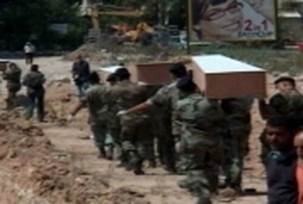 Lebanon         Coffins brought to mass grave