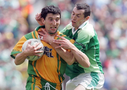 Michael Hegarty is accosted by Fermanagh's Raymond Johnston