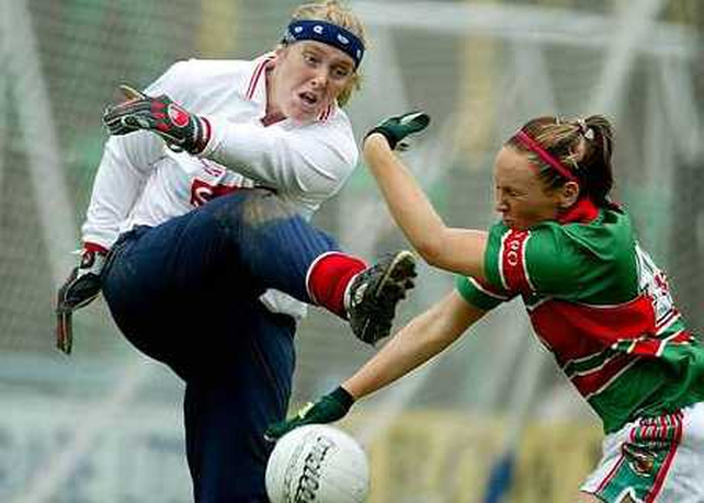 Cork goalkeeper Elaine Harte is put under pressure by Mayo's Triona McNicholas