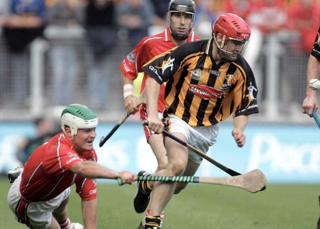 Kilkenny's Tommy Walsh breaks away from the attention of Cork's Niall McCarthy