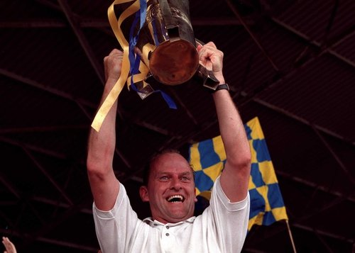 Ger Loughnane with the Liam McCarthy Cup draped in Clare colours