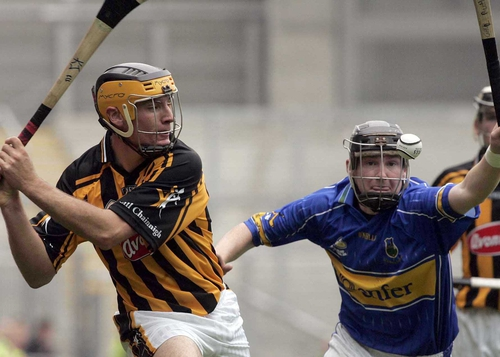 Kieran Joyce of Kilkenny clears whilst under pressure from Richie Ruth of Tipperary