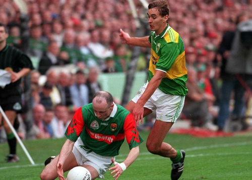 Mayo's Pat Holmes gathers the ball under pressure from Kerry's Maurice Fitzgerald in the 1997 All-Ireland SFC final