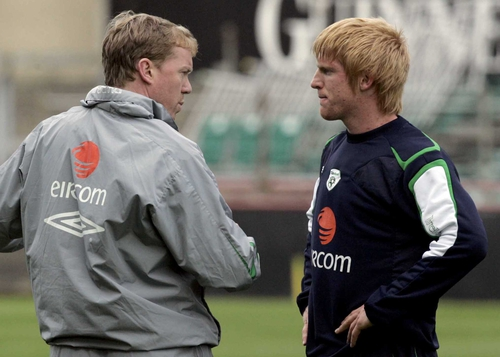 Steve Stauinton talks tactics with Paul McShane during training yesterday