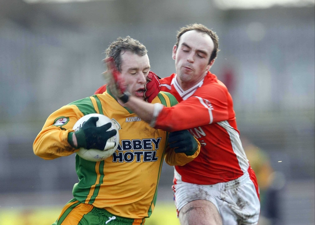 Donegal's Barry Monaghan tussles with Armagh's Malachy Mackin at Omagh