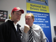 Mr Fixer (PJ Gallagher) with Tommy Gorman, head of taxi union