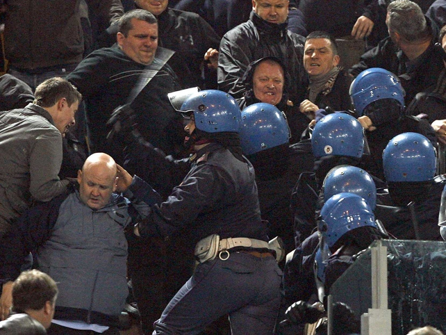 News of Sunday's shooting prompted trouble on the terraces at the game between Atalanta and AC Milan in Bergamo