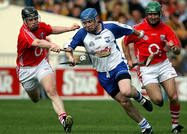 Waterford's Shane Walsh runs past Cork's Shane O'Neill in NHL Division One semi-final in Thurles