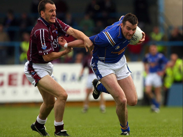 Longford's Liam Keenan under pressure from Westmeath's Damien Healy