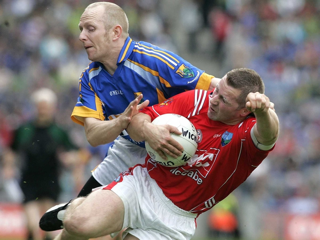 Wicklow's Tommy Gill tackles Louth's Alan Page