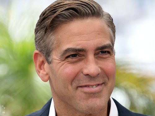 Clooney - All smiles on the red carpet at the Cannes Film Festival