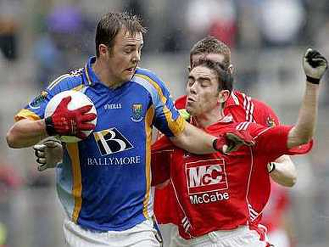 Wicklow's James Stafford shields the ball from John O'Brien of Louth