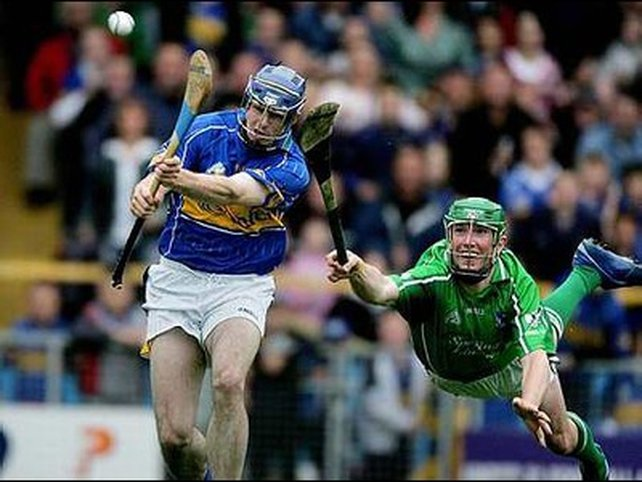 Seamus Hickey (r) tries to stop Seamus Butler from scoring Tipperary's opening goal