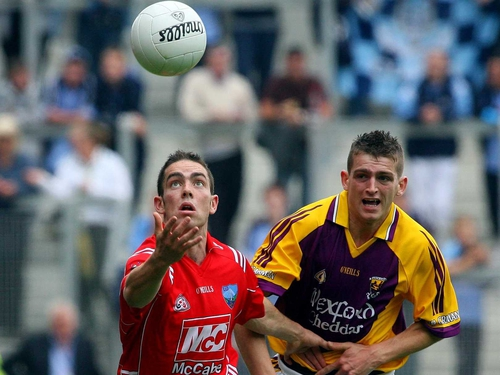 Louth's John O'Brien (left) and Wexford's Adrian Flynn chase the ball