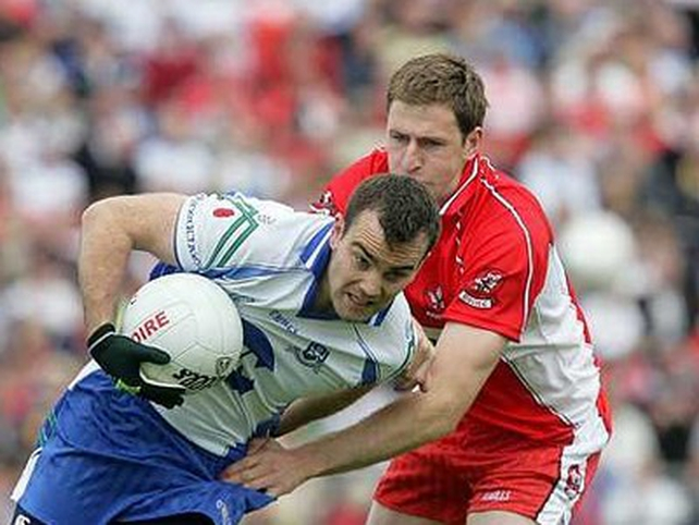 Monaghan's John Paul Mone is tackled by Enda Muldoon of Derry