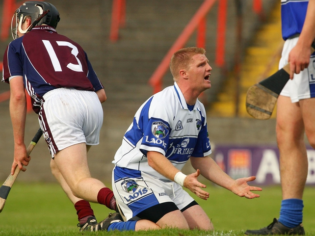 Laois goalkeeper Patrick Mullaney looks to his team-mates as Niall Healy of Galway scores a goal