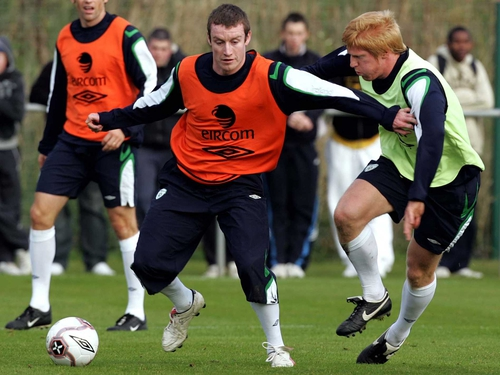 Stephen Elliott holds off Paul McShane during an Ireland training session