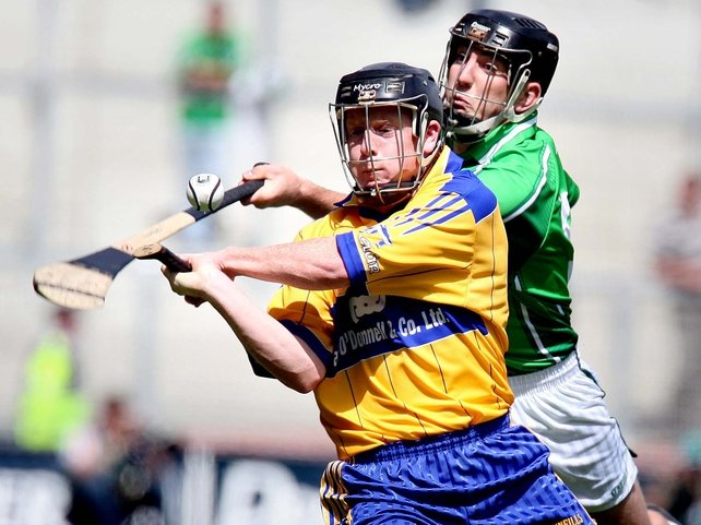 Clare's Niall Gilligan is pursued by Limerick's Donal O'Grady