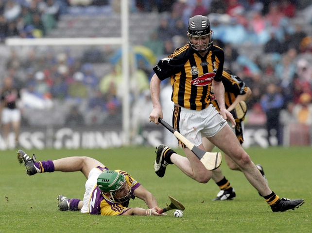 Kilkenny's Martin Comerford skips away from a grounded Keith Rossiter