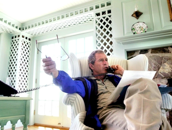 President George W Bush - Receiving 'regular updates' while on holiday in Maine