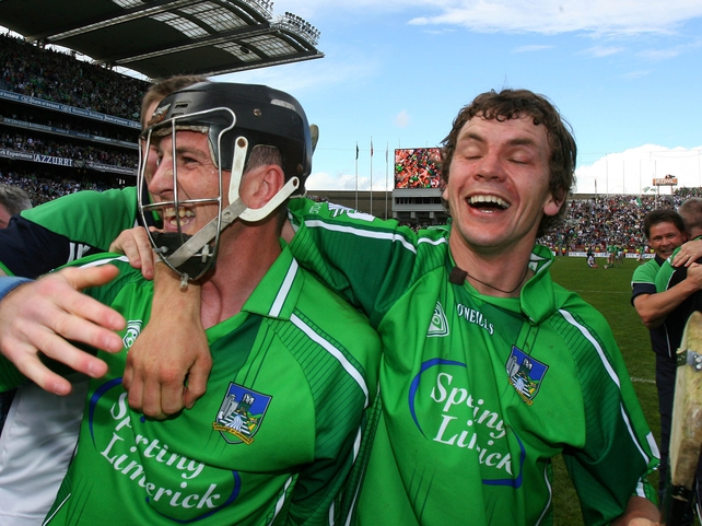 Limerick's Mark O'Riordan and Mike O'Brien celebrate at the final whistle
