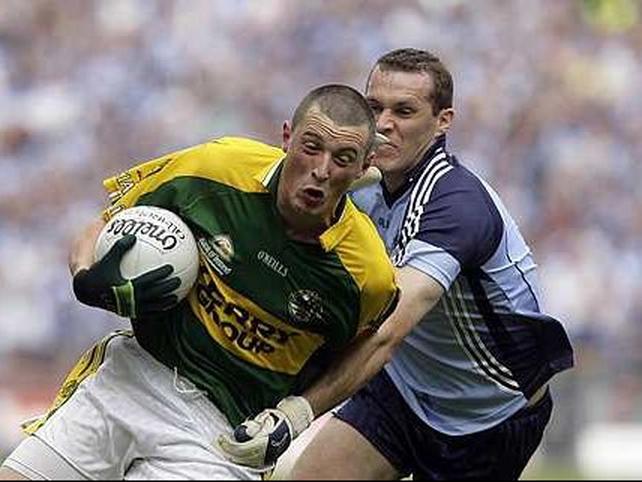 Kieran Donaghy evades a challenge from Ciaran Whelan